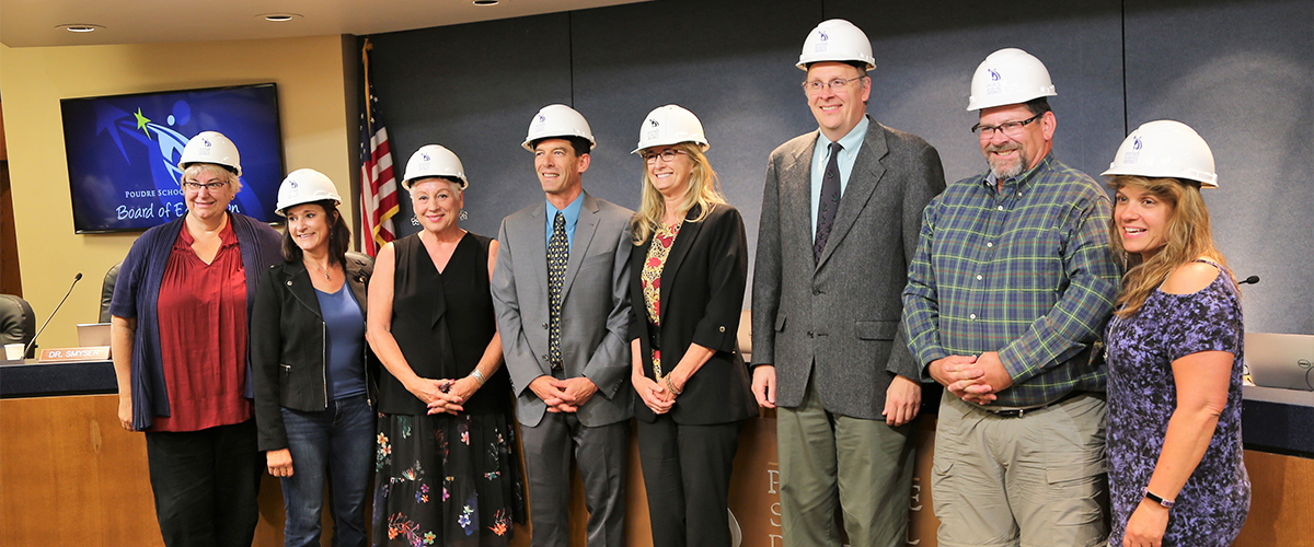 Board of Education members pose with hard hats