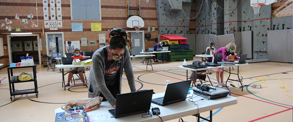 Olander staff work on donated laptops