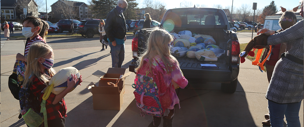 Students drop off turkeys for the Food Bank.