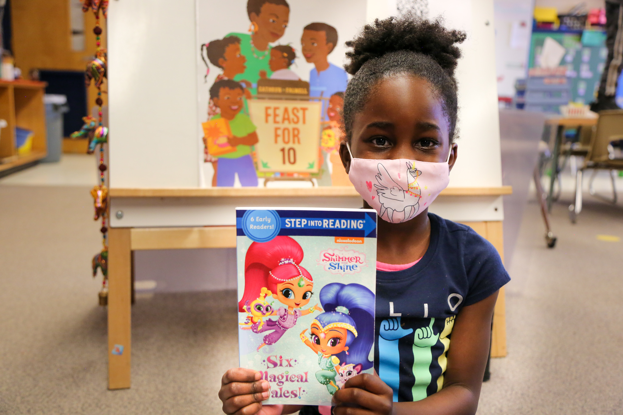 A Bennett Elementary student holds up a book given to her.