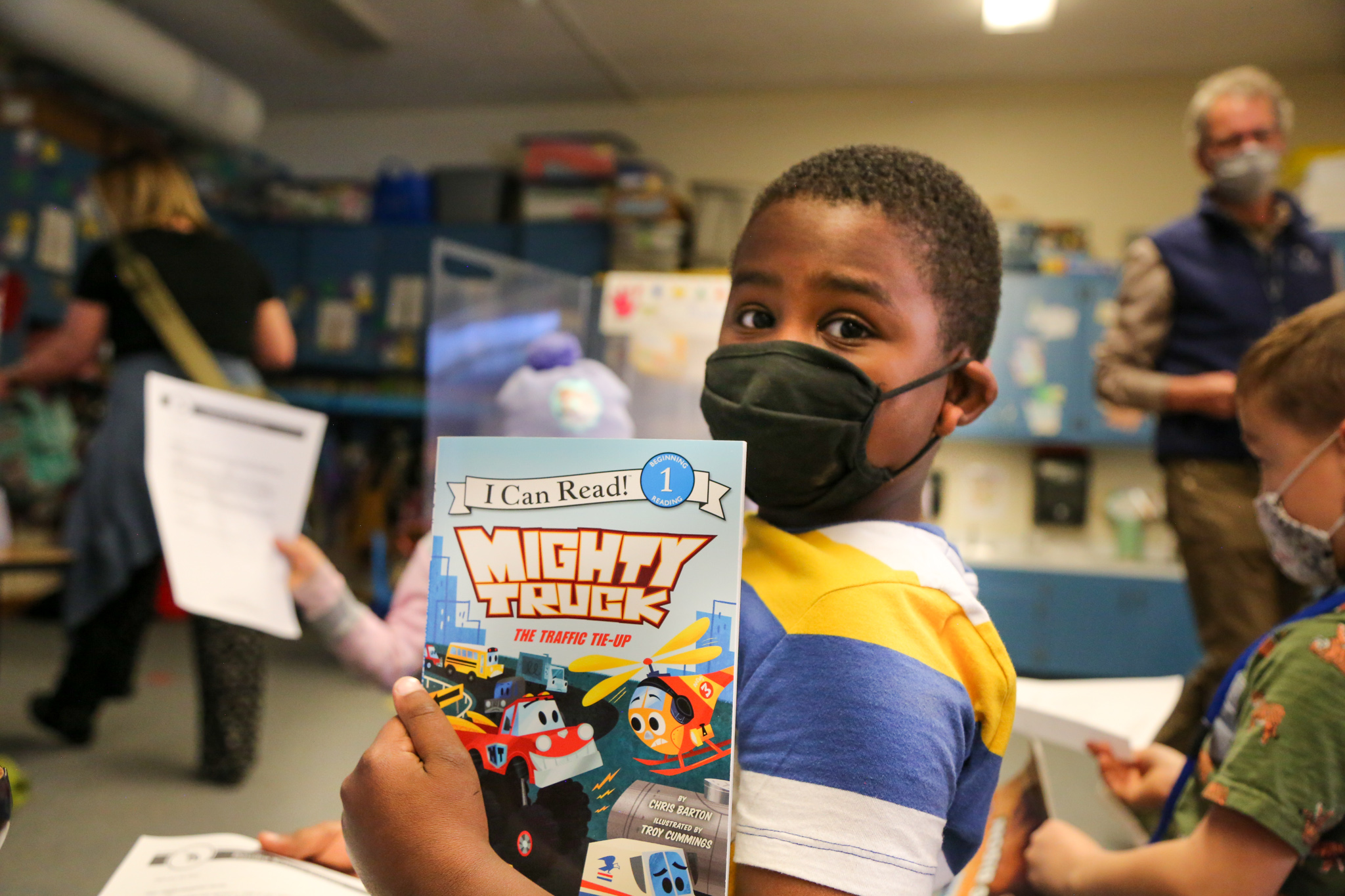 A Dunn Elementary student holds up a book.