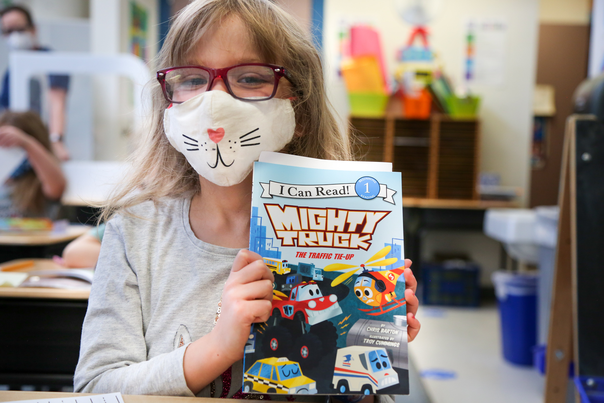 A Werner Elementary student holds up her book.
