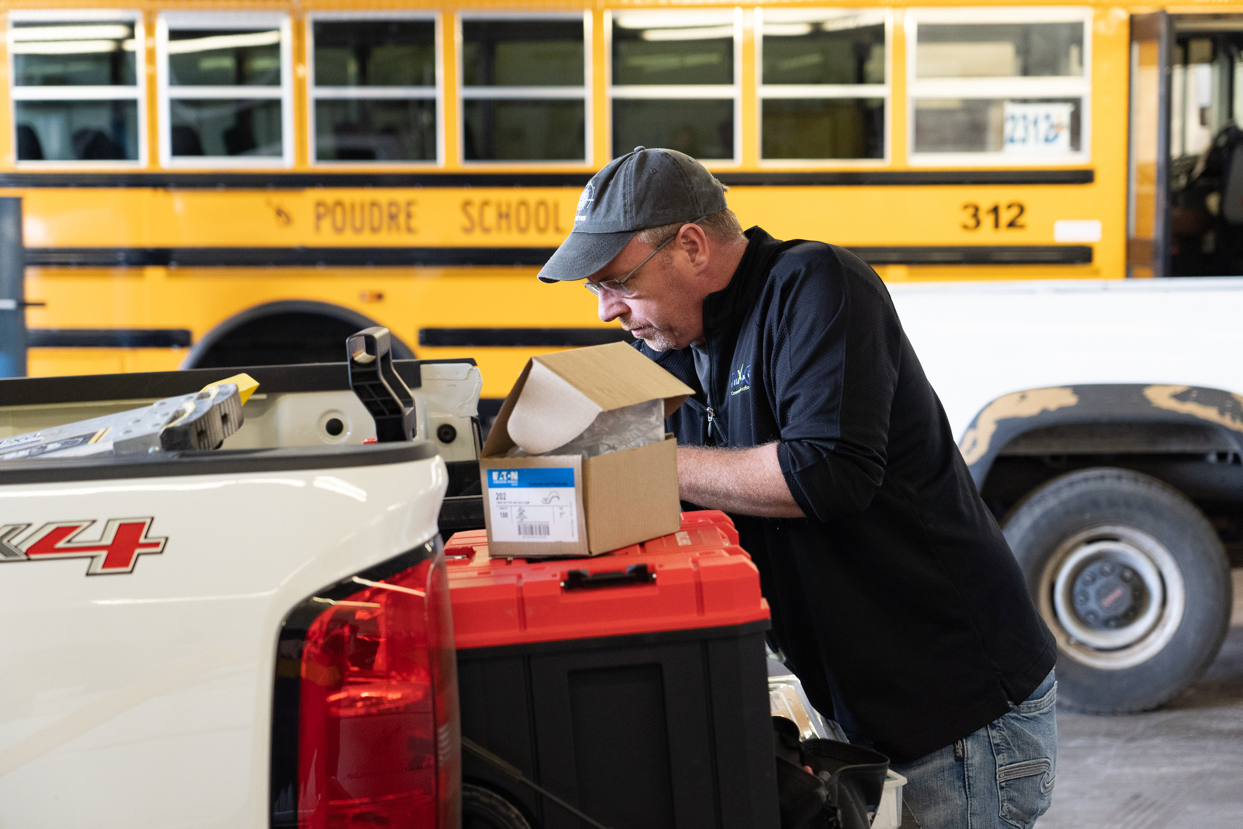 Staff work on a hotspot vehicle to make Internet available to students who don't have it.