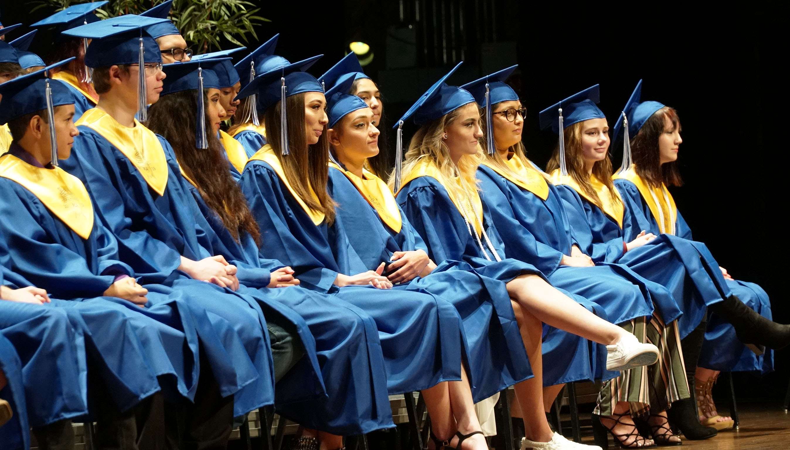 PCA graduates sitting down during the ceremony.