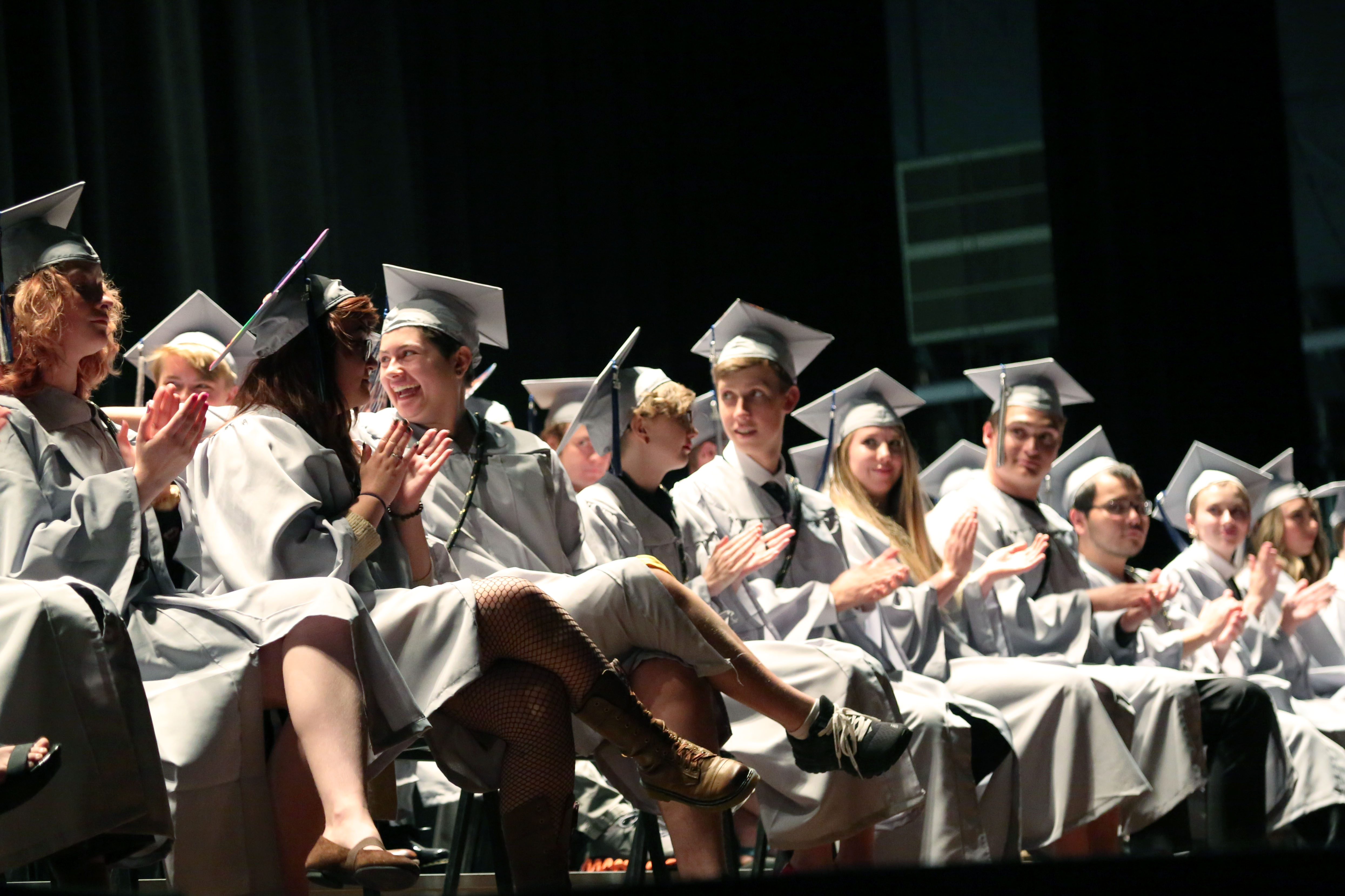 Polaris graduates clap and smile during the ceremony.