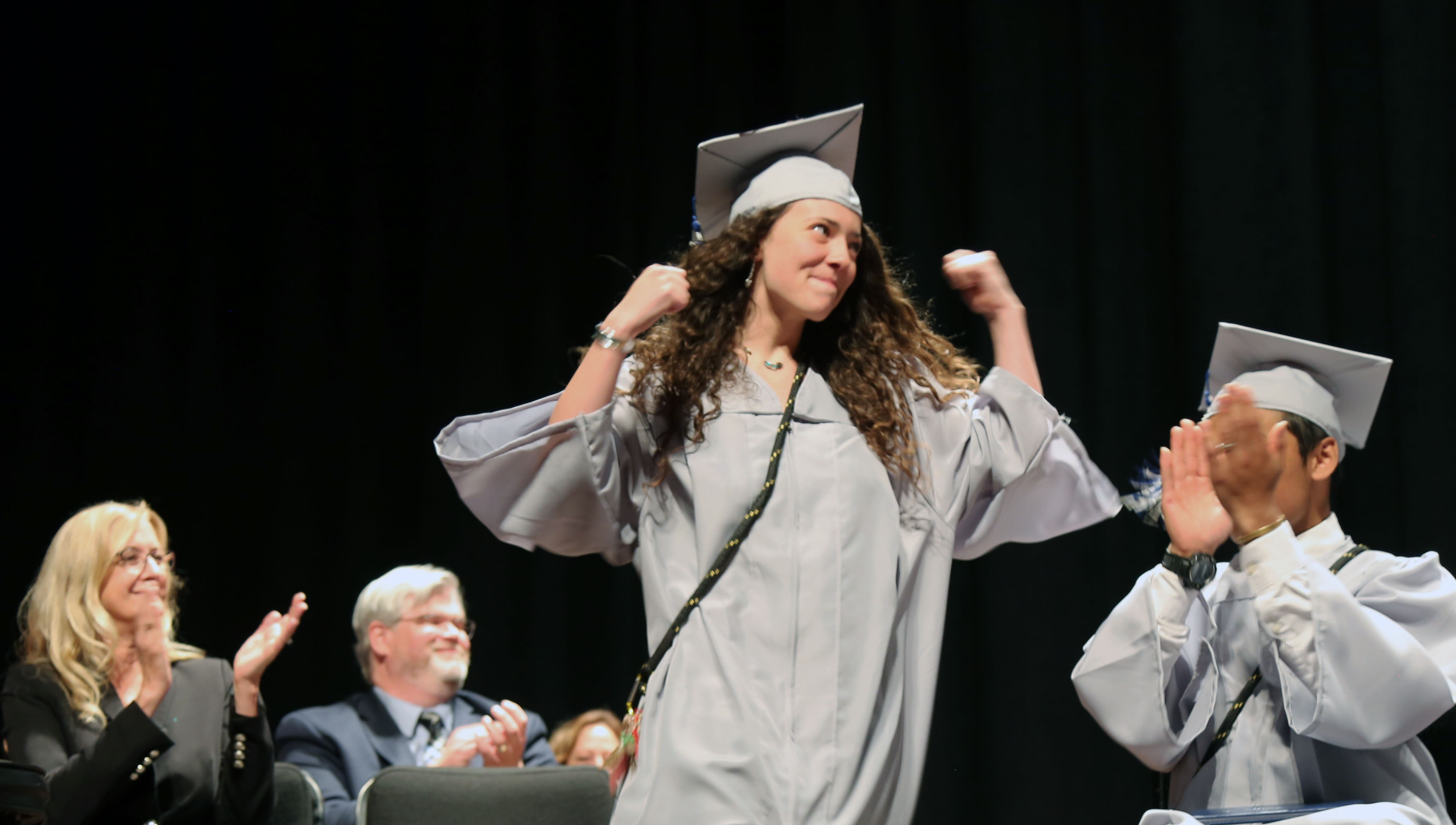 A Polaris grad cheers for her accomplishment.