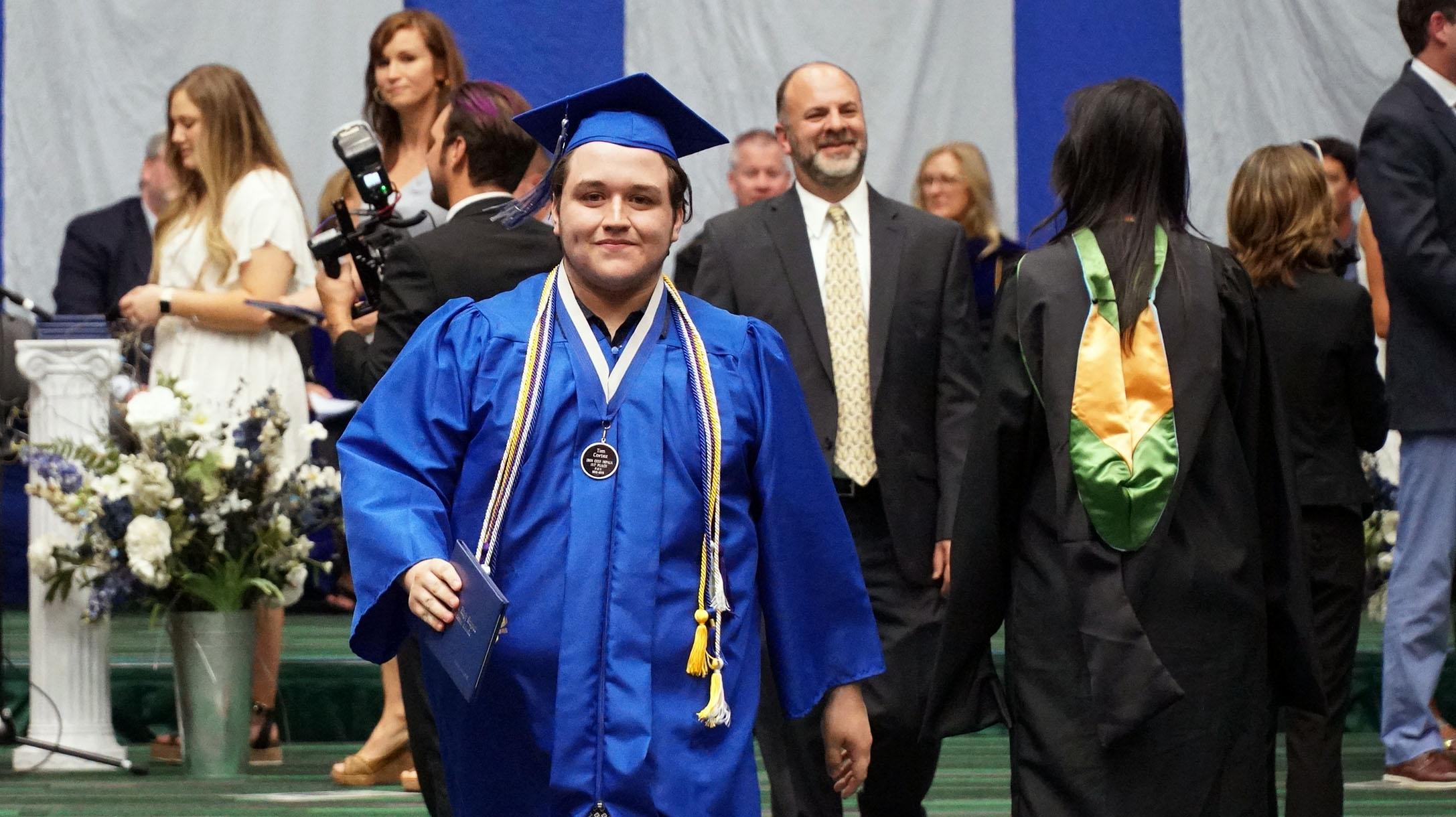 A Pouidre High School grad walks away with his diploma.