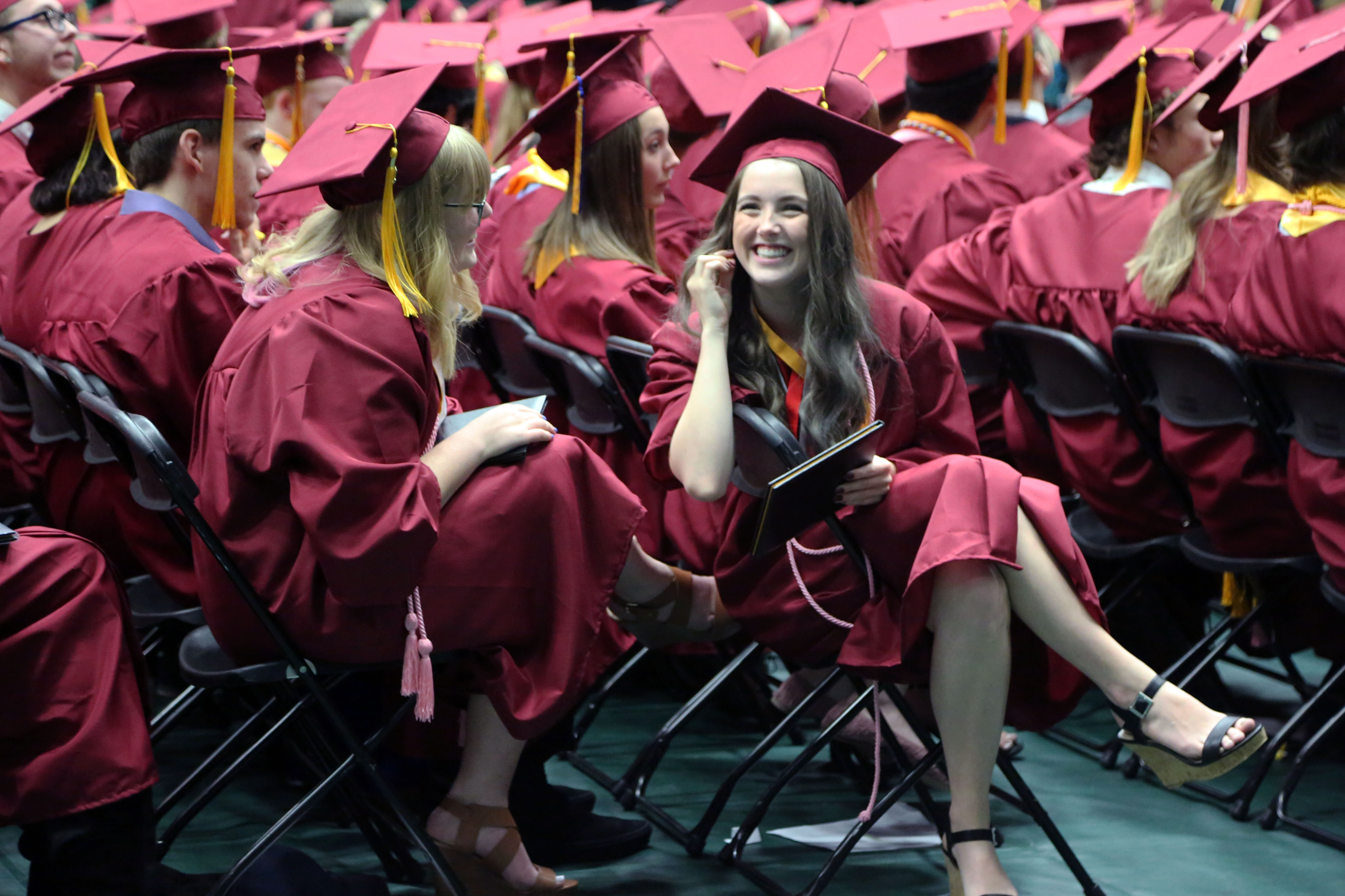 Rocky grads chat while waiting in their seats.