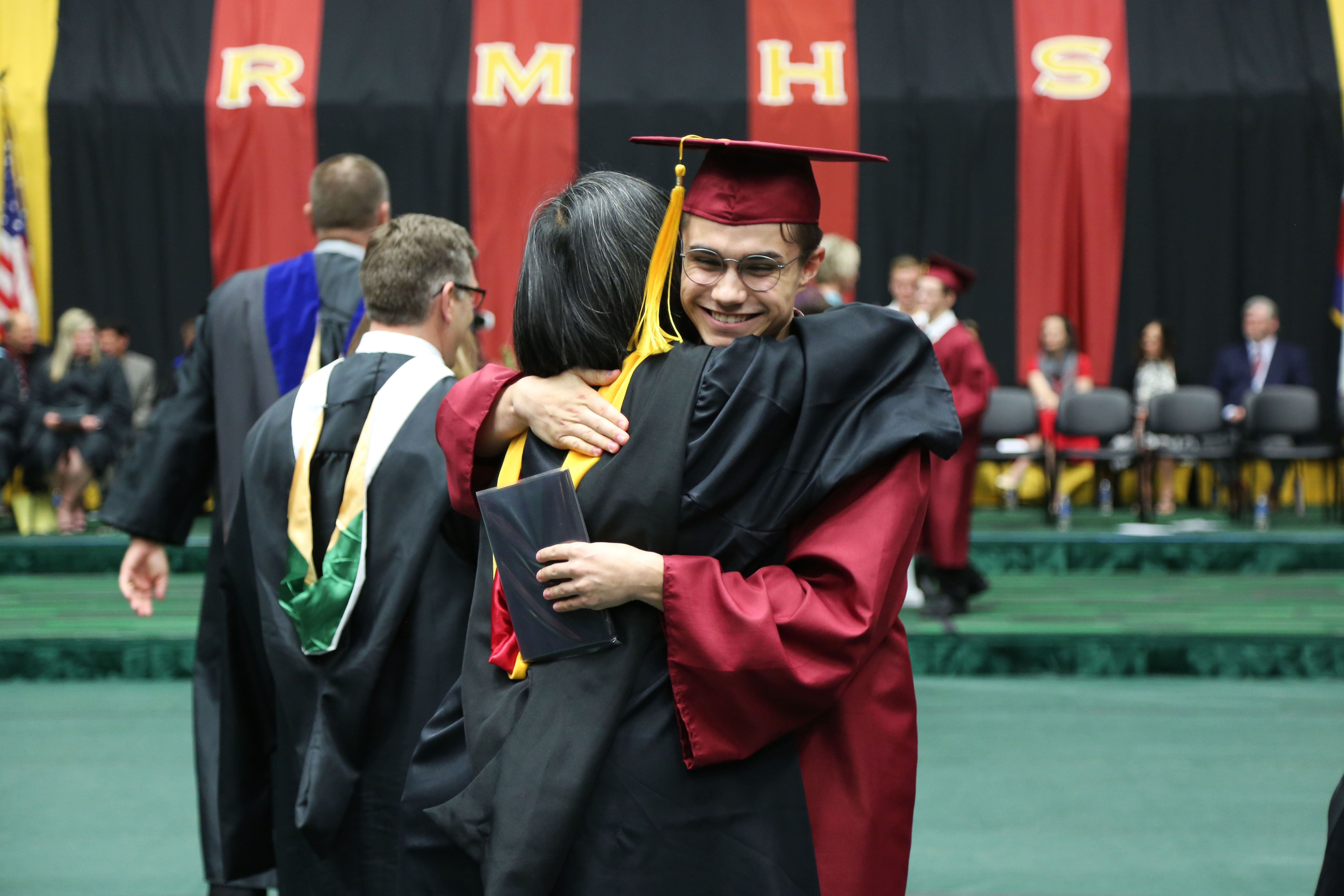 A Rocky grad hugs a teacher.