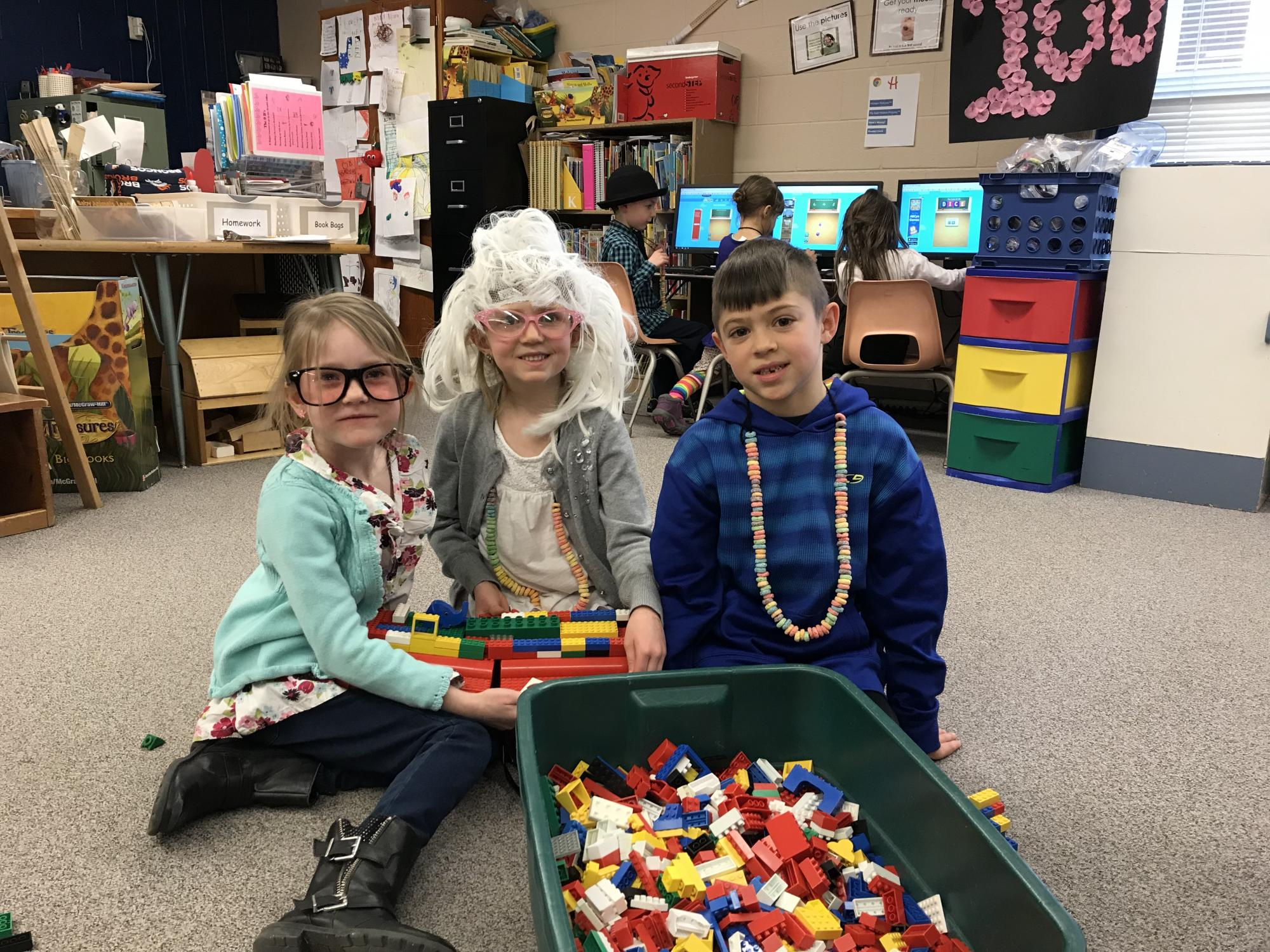 Three Beattie students with 100 legos and blocks.