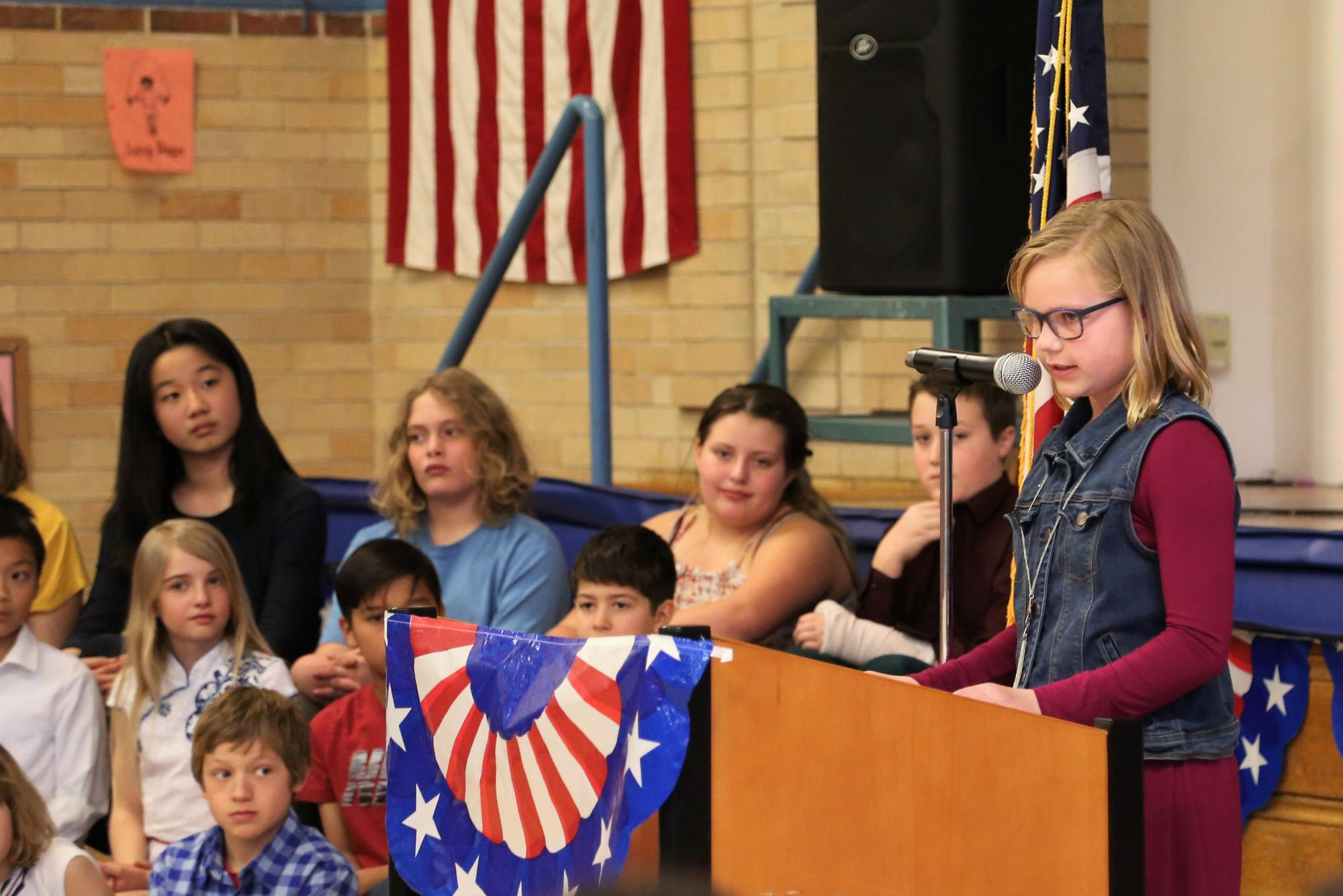 Fifth-grader Harper Skejerseth spoke to soon to be new citizens.