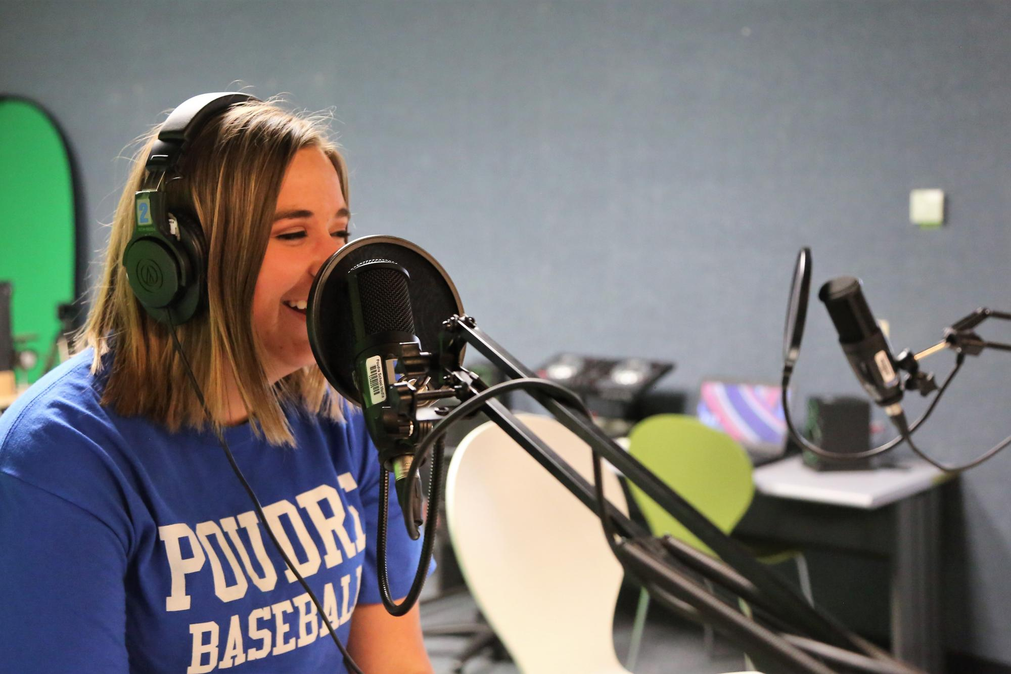 A female PHS student uses recording equipment in the PHS MakerSpace area.