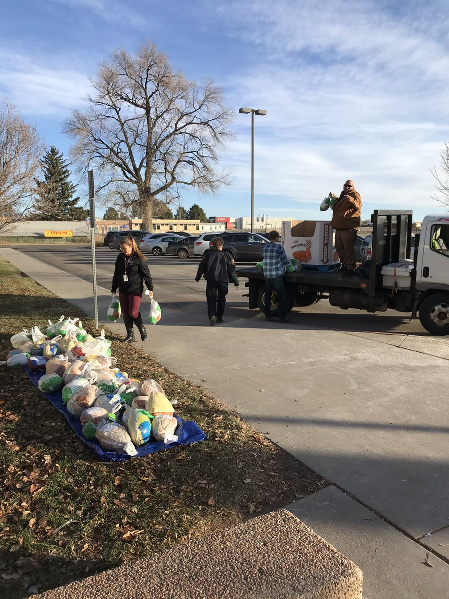A pile of donated frozen turkeys sits outside Wellington Middle School.