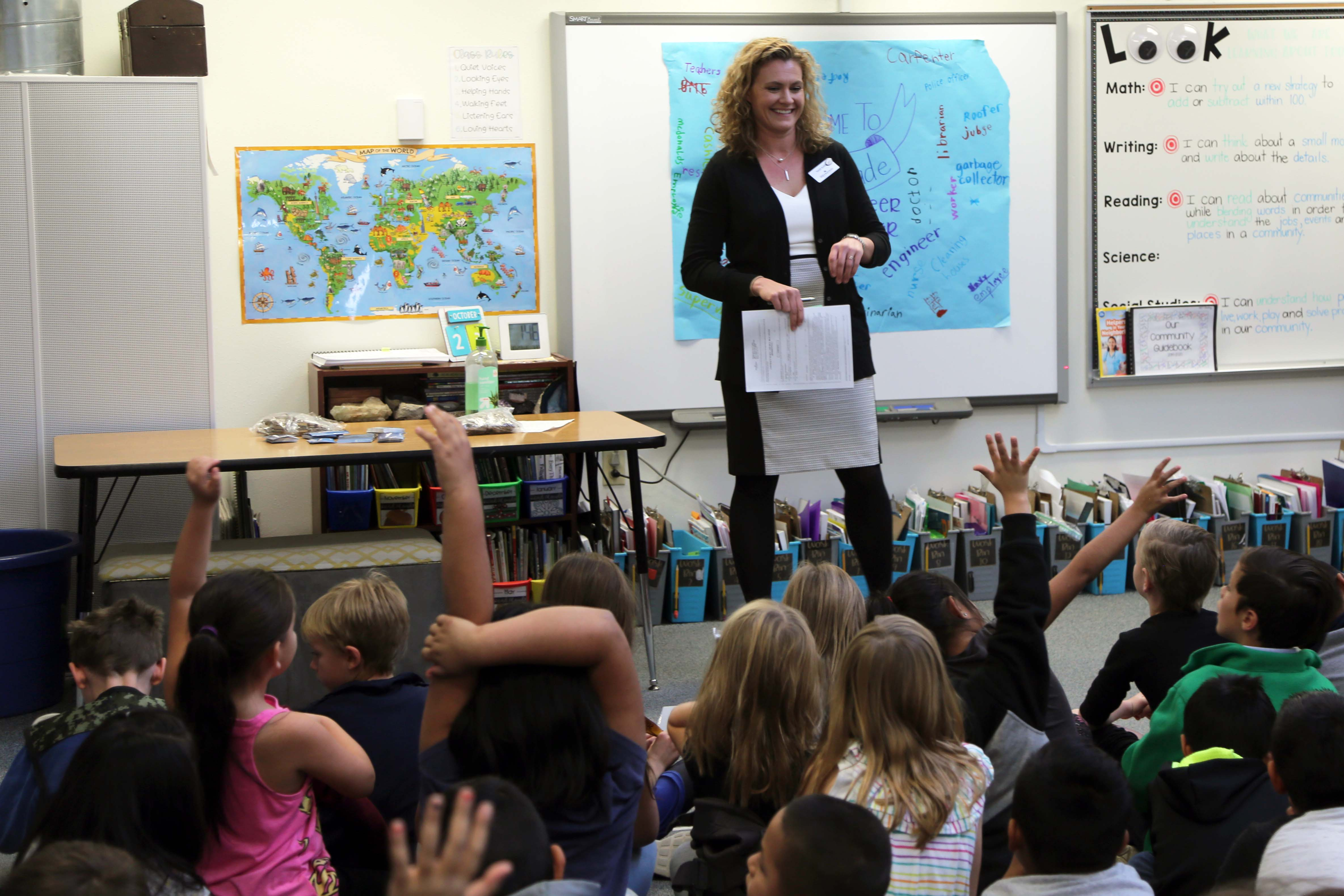 A Linton Elementary parent speaks to a class on Career Day.