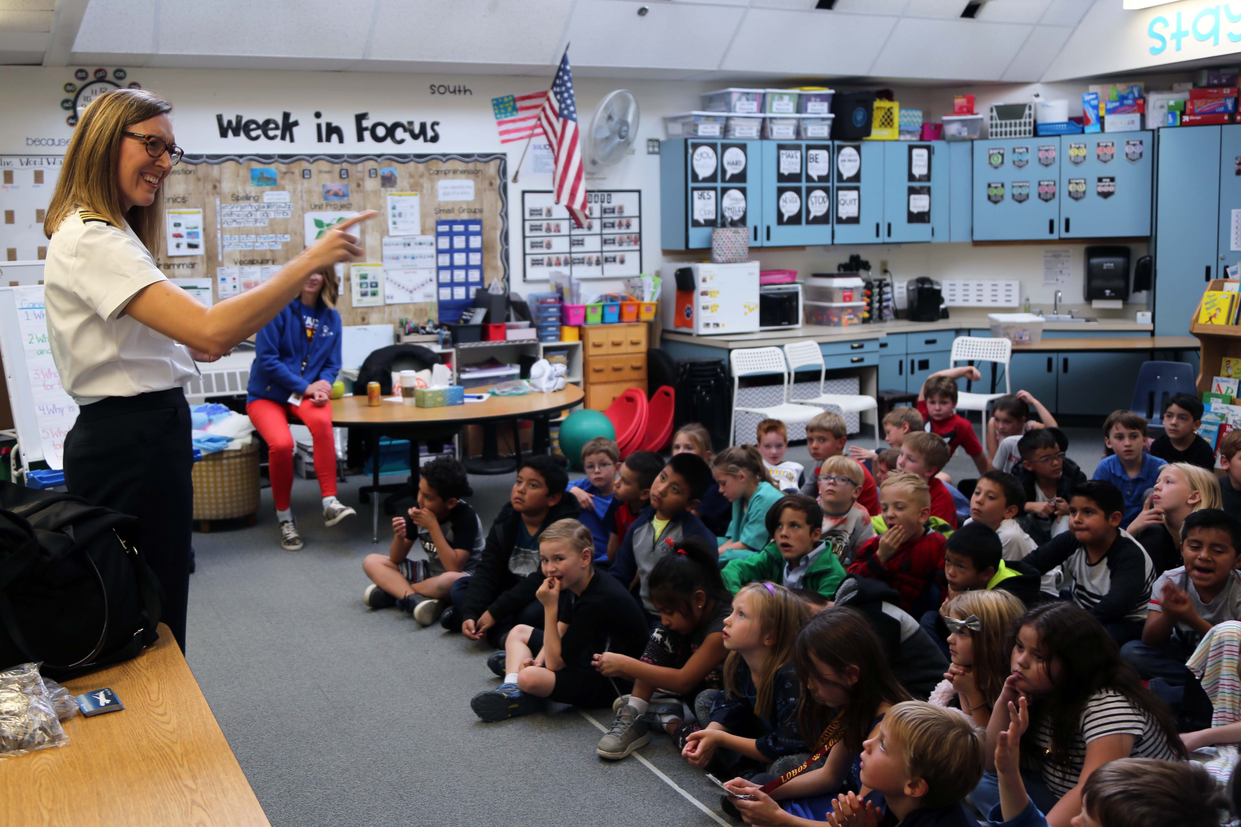 A pilot and mother of a Linton Elementary student talks to a class at Linton.