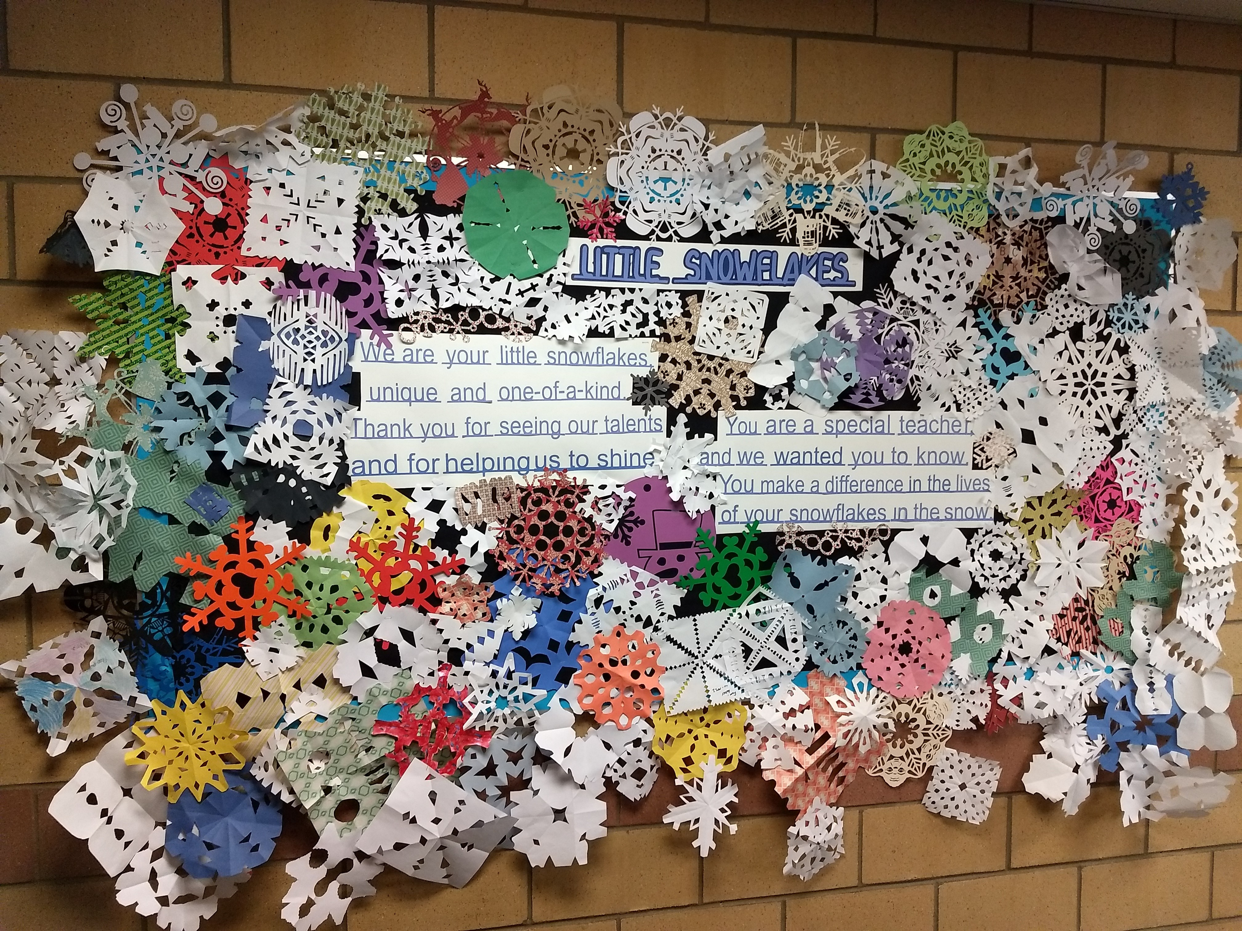 Bulletin board at Kruse Elementary displaying many paper snowflakes.