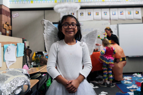 A girl dressed up as an angel for Halloween.