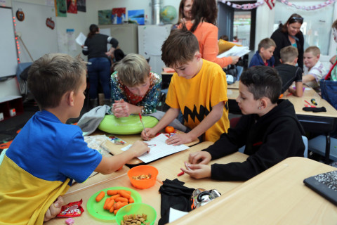 A group of boys play a Halloween game.