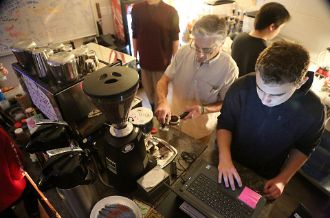 Student employees make coffee at Fossil's Cup of Joe cafe.