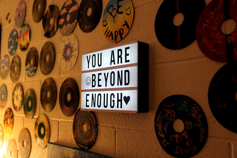 "A ""You Are Beyond Enough"" sign hangs on a wall at Cup of Joe."