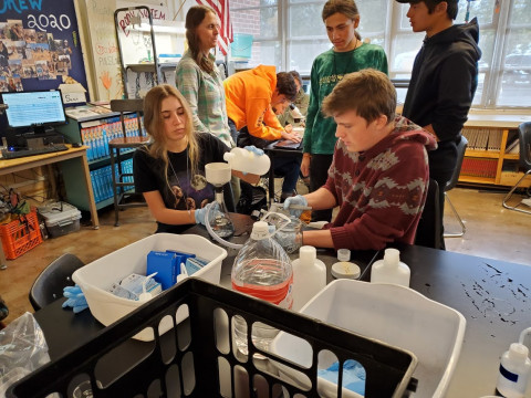 Two Polaris students work together on tests for microplastics in local water samples.
