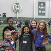 Lincoln girls pose in the CSU gym