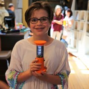 A Preston girl holds a completed solar-powered lantern.
