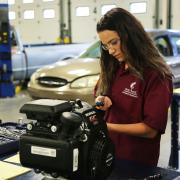 PHS student Jada Barry works in an automotive class at Front Range Community College.