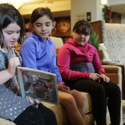 Johnson students read a story to seniors at Morning Star Residential Home.