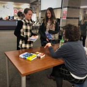 Two Webber Middle School girls visit with author Deborah Hopkinson.
