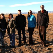 PSD Board of Education members and Superintendent Sandra Smyser stand where the new Wellington school will be located.