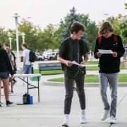 Two students walk into Fossil Ridge High School on the first day of school.