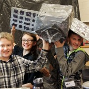 Webber Middle School students hold up a space satellite.