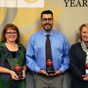 2019 Rotary Teachers of the Year - Cesar Fuentes, Krista Brakhage and Jane Ryan - stand together holding their award.