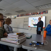 Gov. Polis stands in front of a class of Poudre High School students, explaining how a bill becomes a law.