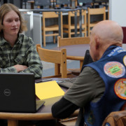 A Poudre High School student talks with a veteran.
