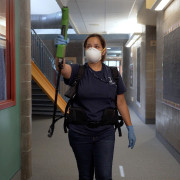 A custodial staff member cleans a hallway.