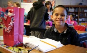 Elementary school boy sitting at his desk